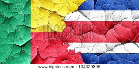 Benin flag with Costa Rica flag on a grunge cracked wall
