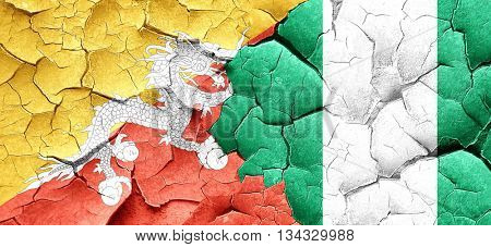 Bhutan flag with Nigeria flag on a grunge cracked wall