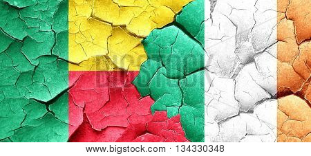 Benin flag with Ireland flag on a grunge cracked wall