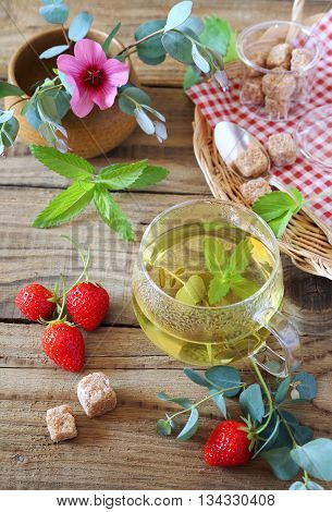 Summer composition with herbal tea of mint eucalyptus and strawberry