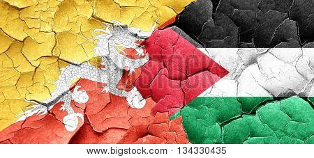 Bhutan flag with Palestine flag on a grunge cracked wall
