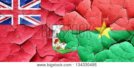 bermuda flag with Burkina Faso flag on a grunge cracked wall