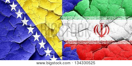 Bosnia and Herzegovina flag with Iran flag on a grunge cracked w