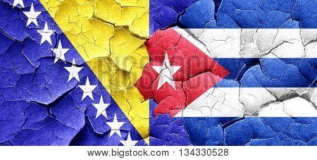 Bosnia and Herzegovina flag with cuba flag on a grunge cracked w