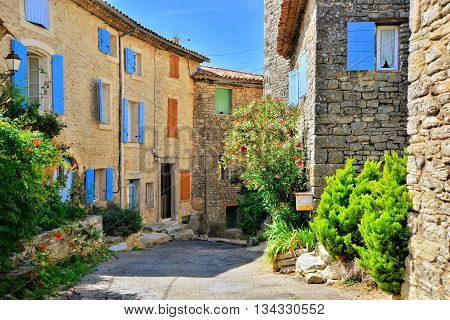 Pretty Houses With Colorful Shuttered Windows In A Quaint Village In Provence, France