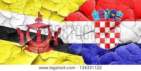 Brunei flag with Croatia flag on a grunge cracked wall