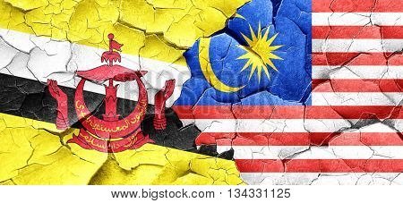 Brunei flag with Malaysia flag on a grunge cracked wall