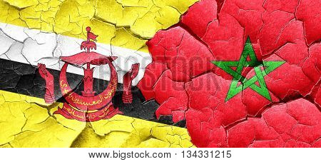 Brunei flag with Morocco flag on a grunge cracked wall