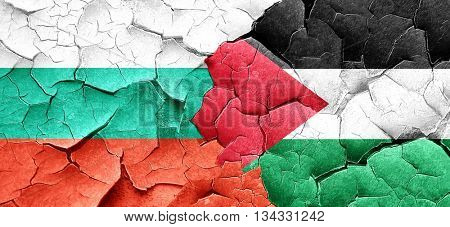 bulgaria flag with Palestine flag on a grunge cracked wall