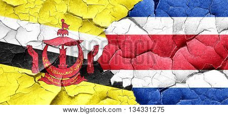Brunei flag with Costa Rica flag on a grunge cracked wall