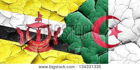 Brunei flag with Algeria flag on a grunge cracked wall