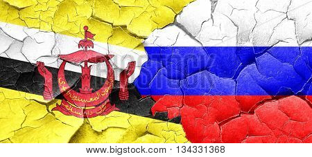 Brunei flag with Russia flag on a grunge cracked wall