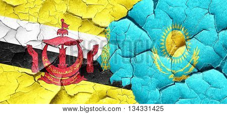 Brunei flag with Kazakhstan flag on a grunge cracked wall