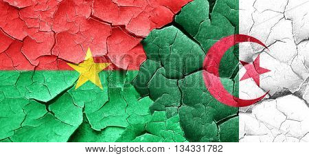 Burkina Faso flag with Algeria flag on a grunge cracked wall