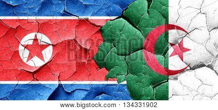 North Korea flag with Algeria flag on a grunge cracked wall