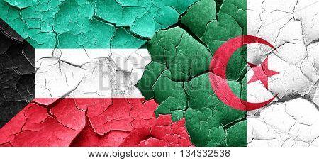 Kuwait flag with Algeria flag on a grunge cracked wall