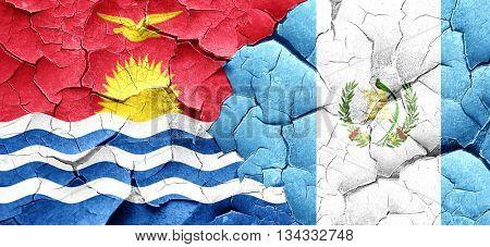 Kiribati flag with Guatemala flag on a grunge cracked wall