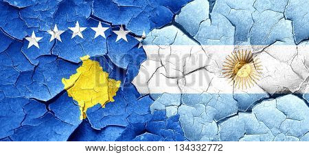 Kosovo flag with Argentine flag on a grunge cracked wall