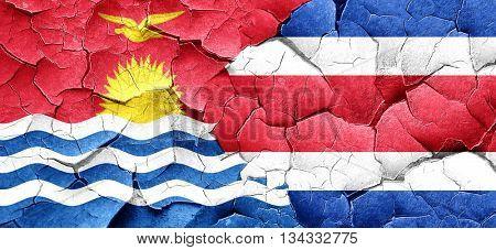 Kiribati flag with Costa Rica flag on a grunge cracked wall
