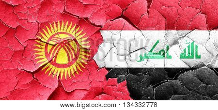 Kyrgyzstan flag with Iraq flag on a grunge cracked wall
