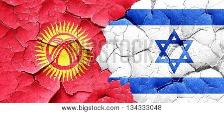Kyrgyzstan flag with Israel flag on a grunge cracked wall