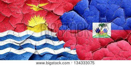 Kiribati flag with Haiti flag on a grunge cracked wall