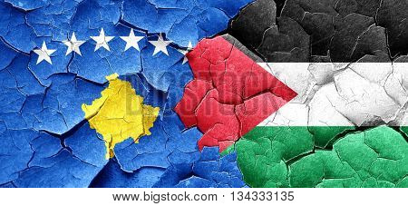 Kosovo flag with Palestine flag on a grunge cracked wall