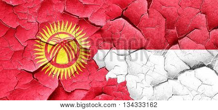 Kyrgyzstan flag with Indonesia flag on a grunge cracked wall