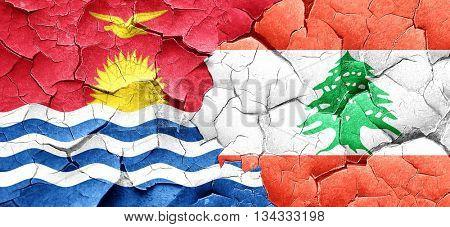 Kiribati flag with Lebanon flag on a grunge cracked wall
