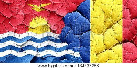 Kiribati flag with Romania flag on a grunge cracked wall