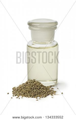 Bottle with anise oil and seeds on white background