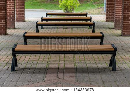 Benches At A Bus Stop under a brick pavilion