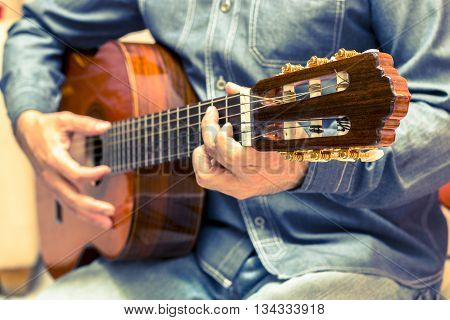 Vintage guitar player in artistic performance show