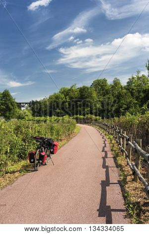 The bicycle path of the Lambro river in Brianza (Lombardy Italy) at spring: a bicycle with red bags
