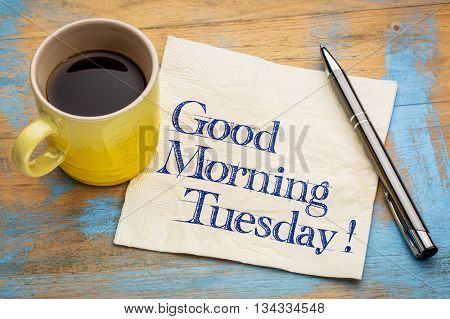 Good Morning Tuesday - handwriting on a napkin with a cup of espresso coffee