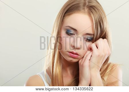 Loneliness negative emotion concept. Young sad stressed woman closeup