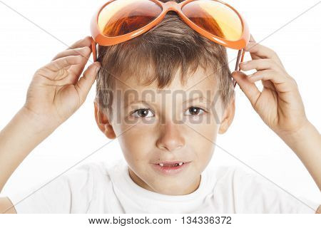 little cute boy in orange sunglasses pointing isolated on white background close up part of face