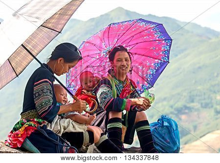 SAPA, VIETNAM, February 19, 2016 the group of women, ethnic Hmong, high mountains, Sapa, Vietnam. always bring small children on their backs