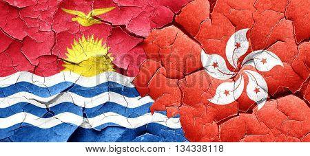Kiribati flag with Hong Kong flag on a grunge cracked wall