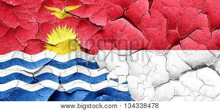 Kiribati flag with Indonesia flag on a grunge cracked wall
