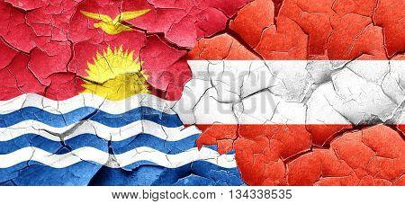 Kiribati flag with Austria flag on a grunge cracked wall