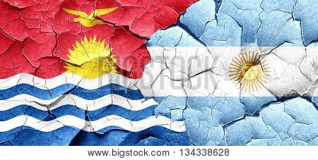 Kiribati flag with Argentine flag on a grunge cracked wall