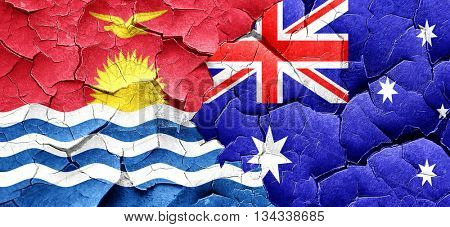 Kiribati flag with Australia flag on a grunge cracked wall