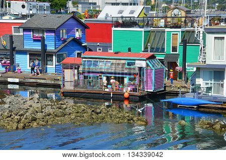 VICTORIA BC CANADA JUNE 19 2015: Victoria Inner Harbour, Fisherman Wharf is a hidden treasure Area has floating homes, boats, piers, and restaurants and eco-tour adventures