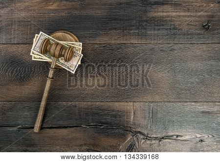 Judges Gavel with US dollar. Auctioneer hammer on wooden background