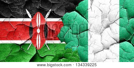 Kenya flag with Nigeria flag on a grunge cracked wall