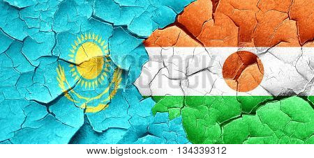 Kazakhstan flag with Niger flag on a grunge cracked wall
