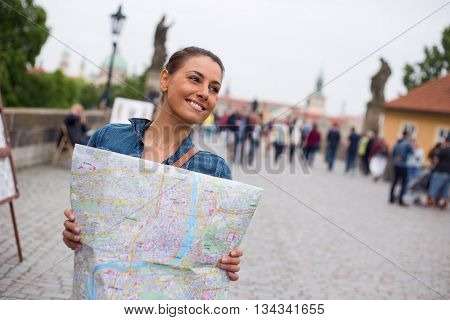 a tourist in Prague holding a map