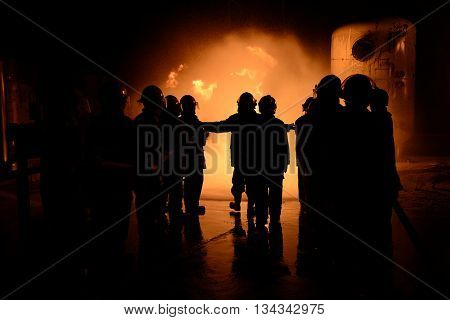 Emergency Fire Rescue concept , Several firefighters go offensive for a fire attack