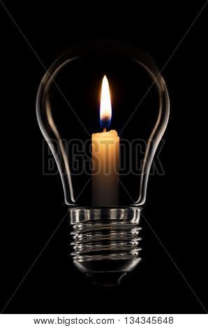 Lightbulb with candle flaming inside isolated on black background and clipping path